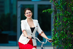 Young elegant business woman with bicycle Royalty Free Stock Images