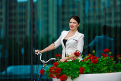 Young elegant business woman with bicycle Stock Images