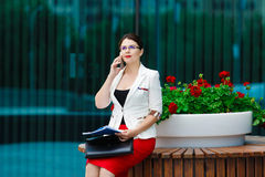 Young elegant business woman with mobile phone Royalty Free Stock Images