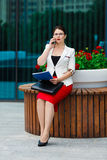 Young elegant business woman with mobile phone Royalty Free Stock Photos