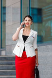 Young elegant business woman with mobile phone Stock Photography