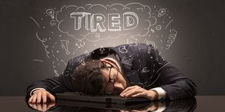 Businessman fell asleep at his workplace with ideas, sleep and tired concept stock photo