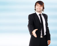 Young elegant businessman reaching open hand Stock Photography