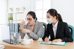 Company manager woman having nose allergy problem Royalty Free Stock Photo