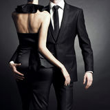Young elegant couple. Conceptual portrait of a young couple in elegant evening dresses Stock Image