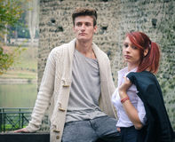 Young elegant couple outdoors near old stone wall Royalty Free Stock Images