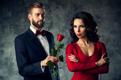 Young elegant couple with rose Stock Photos