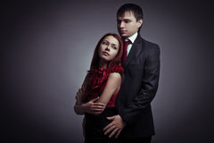 Young elegant couples in the tender passion stock photography