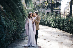 Young elegant fashion couple in park. Lovers lifestyle walk in city of Rome Italy palm tree Royalty Free Stock Images