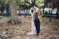 Young elegant fashion couple in park royalty free stock photography