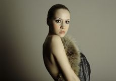 Young elegant girl with fur coat Stock Photos