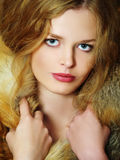 Young elegant girl with fur collar Stock Image