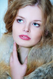 Young elegant girl with fur collar Royalty Free Stock Photography