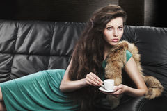 Young elegant girl in green with cup, Stock Photos