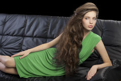 Young elegant girl in green dress Stock Photo