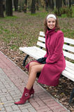 Young elegant girl in purple coat Royalty Free Stock Photography
