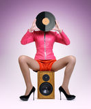 Young elegant lady with a vinyl disc Stock Photos