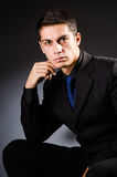 The young elegant man against gray Royalty Free Stock Photo