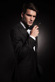Young elegant man holding a cigarette in his hand. Stock Photo