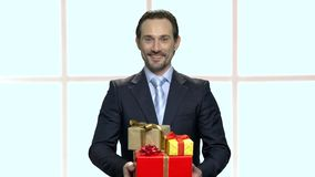 Young elegant man holding gift boxes. stock video footage