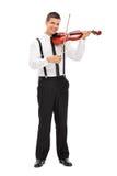 Young elegant man playing a violin Royalty Free Stock Photos