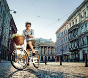 Young elegant man riding a bike Royalty Free Stock Images