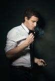 Young elegant man smoking Royalty Free Stock Images