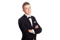 Young elegant man in tuxedo Royalty Free Stock Photos