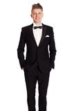 Young elegant smiling man in tuxedo Stock Images