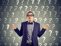 Ignorant man in question marks Stock Images