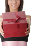 Young elegant woman in black dress with gift Stock Photos