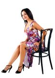Young elegant woman on chair Royalty Free Stock Images