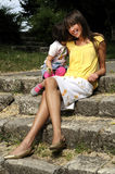 Young elegant woman and child Royalty Free Stock Photos