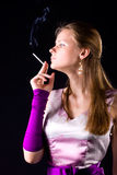 Young elegant woman with cigarette Royalty Free Stock Image
