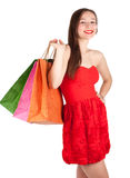 Young elegant woman with coloured bags Stock Photo