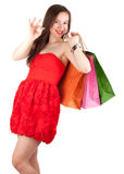 Young elegant woman with coloured bags Stock Images
