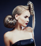 Young elegant woman with creative hair style leopard print close. Up design fashion concept stock image