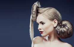 Young elegant woman with creative hair style leopard print close up. Halloween stylish stock image