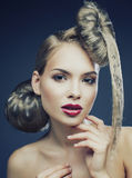 Young elegant woman with creative hair style leopard print close up Royalty Free Stock Photo