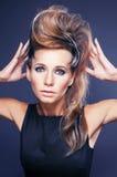 Young elegant woman with creative hair style zebra print close u Stock Photos