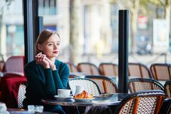 young elegant woman drinking coffee cafe paris france young elegant woman drinking coffee traditional cafe paris 107748531