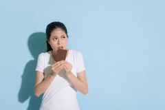 Young elegant woman eating sweet chocolate royalty free stock images