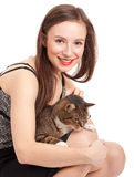 Young elegant woman with grey cat Royalty Free Stock Images