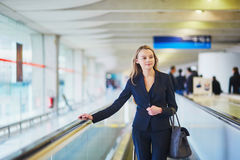 Woman on travelator in the international airport Stock Photo