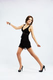 Young elegant woman having fun with a dancing Royalty Free Stock Photos