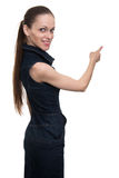 Young elegant woman pointing at copy space Royalty Free Stock Photos