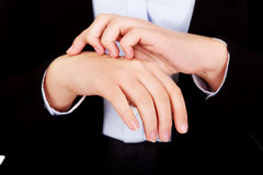 Young elegant woman scratching her hand Stock Photo