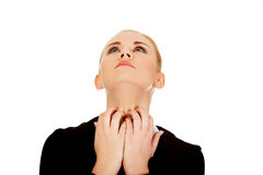 Young elegant woman scratching her neck Royalty Free Stock Image