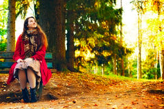 Young elegant woman  sitting on bench Stock Image