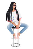 Young elegant woman sitting on a chair Royalty Free Stock Image
